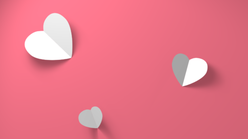 Paper Hearts on red pink background